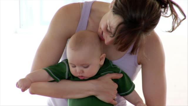 medium shot woman holding baby/ brooklyn, new york - babygro stock videos & royalty-free footage