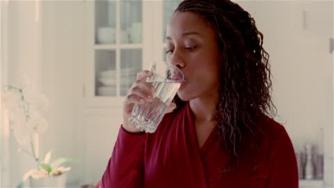 medium shot woman taking pill/ solebury, pennsylvania - moving activity stock videos & royalty-free footage
