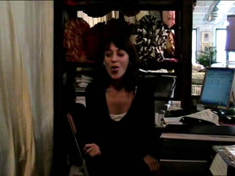 medium shot woman working in shop tries to roll tongue for camera/ woman looking surprised/ new york city - bedclothes stock videos & royalty-free footage