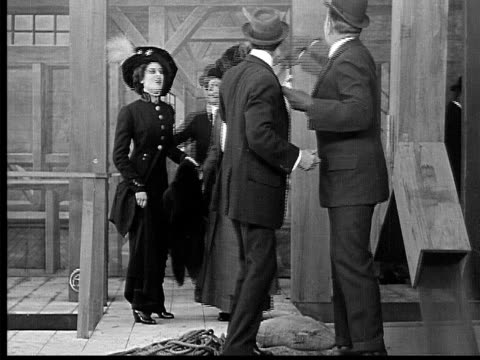 1909 b/w medium shot worker showing tycoon good news during visit to grain mill/ worker leaving and tycoon falling into grain pit  - 19th century style stock videos & royalty-free footage