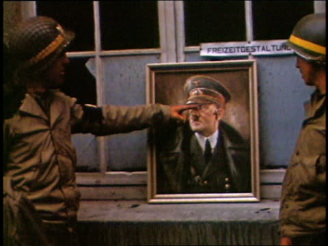 1944 medium shot ww ii us soldiers throwing darts at hitler portrait - fine art portrait stock videos & royalty-free footage