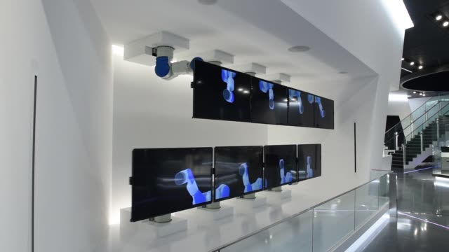 medium shot, yaskawa electric corp motoman robots attached to liquid crystal display monitors are displayed at the companys showroom in kitakyushu,... - liquid crystal display stock videos & royalty-free footage