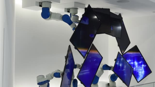 medium shot, yaskawa electric corp motoman robots attached to liquid crystal display monitors are displayed at the companys showroom in kitakyushu,... - flüssigkristallanzeige stock-videos und b-roll-filmmaterial