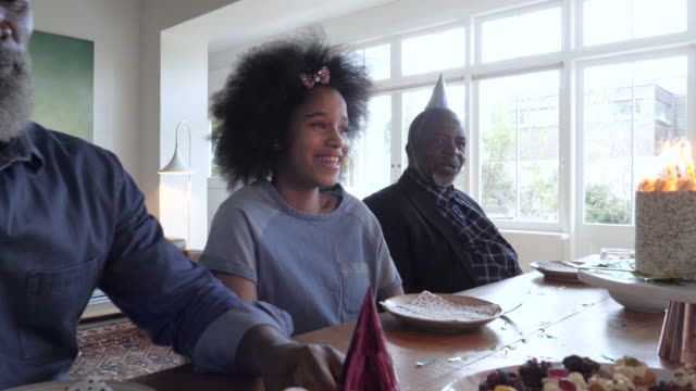 medium shot, young african american girl birthday party - pre adolescent child stock videos & royalty-free footage