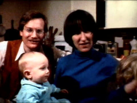 1975 medium shot young couple and two young children posing in kitchen/ zoom in man smoking - 1975 stock videos & royalty-free footage