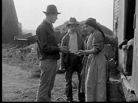 stockvideo's en b-roll-footage met 1909 b/w medium shot young farmer coming home to wife with no food  - 1900 1909