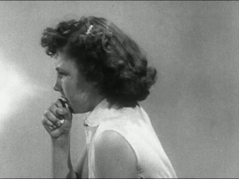1955 Medium shot young girl sneezing with animated mist coming from her nose / AUDIO