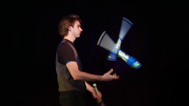 medium shot young man juggling - juggling stock videos & royalty-free footage