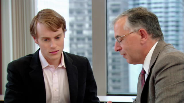 medium shot young man on job interview in businessman's office/ new york, new york - job interview stock videos & royalty-free footage