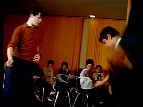 1967 medium shot young men dancing the twist in cafe / kiev, ukraine - twisted stock videos & royalty-free footage