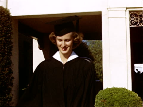 1949 Medium shot Young woman graduate leaving Alpha Chi Omega sorority house at University of California campus / Westwood, Los Angeles, California, USA