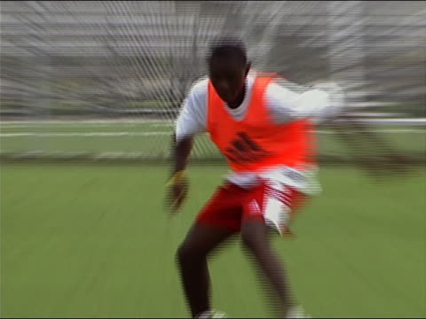 medium shot zoom in pan freddy adu working out during soccer practice / washington dc - 2004 stock videos & royalty-free footage