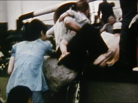 1975 medium shot zoom in people climbing aboard boat during evacuation of saigon / audio / vietnam - 1975 stock videos & royalty-free footage