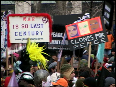 medium shot zoom out anti-war demonstrators waving signs at ny public library / new york city - 30 39 years stock videos & royalty-free footage