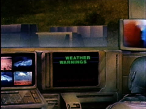 1984 medium shot zoom out graphic of figure watching tv screen 'acid rain alert'  and atomic bomb exploding / audio - forecasting stock videos & royalty-free footage