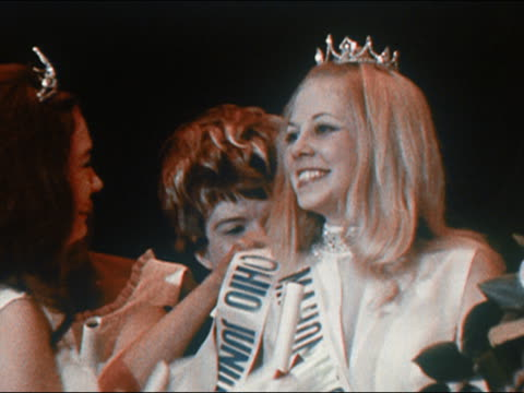1970 medium shot zoom out ohio junior miss 1970 being crowned / receiving sash and flowers - beauty contest stock videos & royalty-free footage