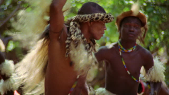 medium shot zulu men in costumes doing native dance / durban, kwazulu-natal, south africa - durban stock videos and b-roll footage