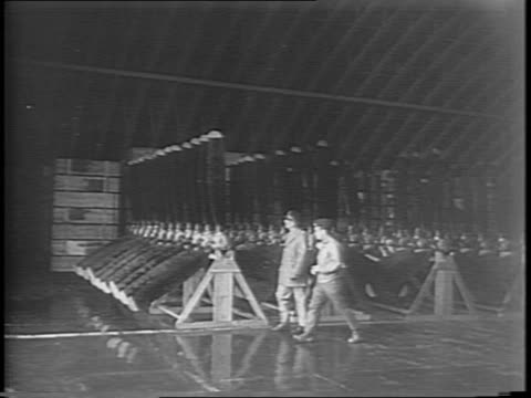 vidéos et rushes de medium shots of general eisenhower meeting with his staff at a table over the european theater of operations in london to plan an invasion / shots of... - 1944
