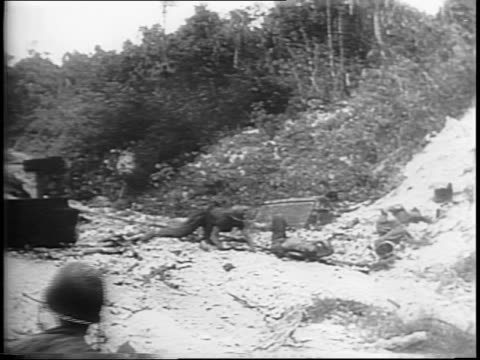 vidéos et rushes de medium shots of tanks and infantry advancing on a dirt road / close-up of feet in trench and on railroad tracks / troops carefully moving along... - infanterie