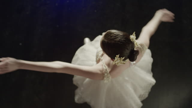 medium slow motion high angle shot of ballerina dancing / salt lake city, utah, united states - balletttänzer stock-videos und b-roll-filmmaterial