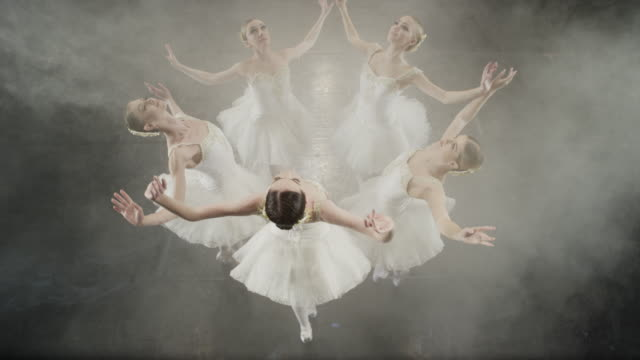 medium slow motion high angle shot of ballerinas dancing in circle / salt lake city, utah, united states - tutu stock videos and b-roll footage