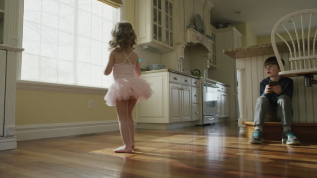 """medium slow motion panning shot of children playing in kitchen / cedar hills, utah, united states"" - wooden floor stock videos & royalty-free footage"