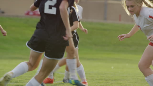 stockvideo's en b-roll-footage met medium slow motion panning shot of girl dribbling soccer ball / springville, utah, united states - meisjes