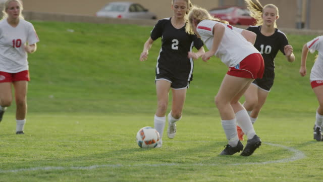 medium slow motion panning shot of girl dribbling soccer ball / springville, utah, united states - springville utah stock videos & royalty-free footage