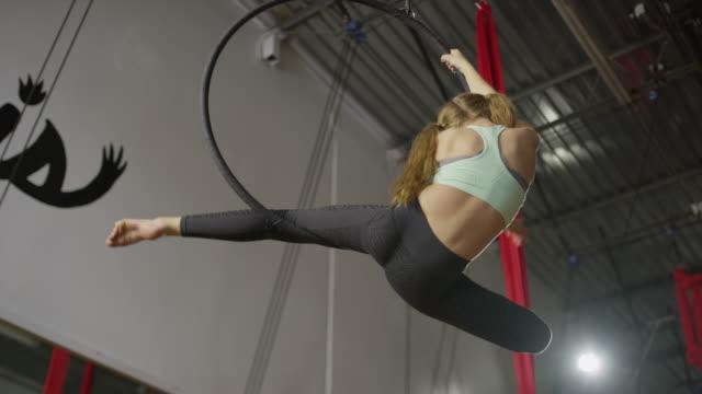medium slow motion panning shot of girl hanging on ring in gymnasium / midvale, utah, united states - leggings stock videos & royalty-free footage