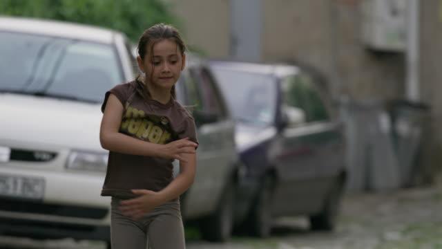 Medium slow motion panning shot of girl performing cartwheels / Veliko Tarnovo, Bulgaria