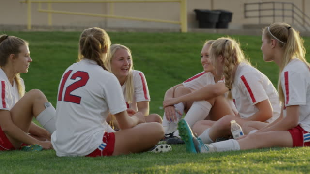 medium slow motion panning shot of girls laughing after soccer match / springville, utah, united states - springville utah stock videos & royalty-free footage