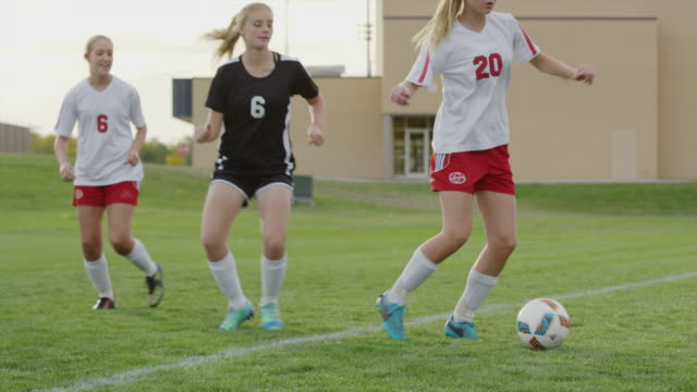 medium slow motion panning shot of girls playing in soccer match / springville, utah, united states - springville utah stock videos & royalty-free footage