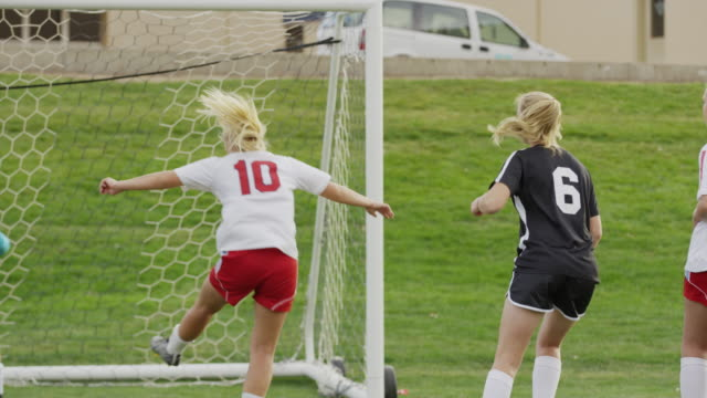 medium slow motion panning shot of soccer team celebrating goal / springville, utah, united states - weiblicher teenager stock-videos und b-roll-filmmaterial