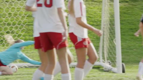medium slow motion panning shot of soccer team celebrating goal / springville, utah, united states - springville utah stock videos & royalty-free footage