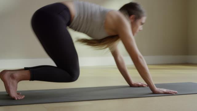 Medium slow motion panning shot of woman performing yoga / Provo, Utah, United States