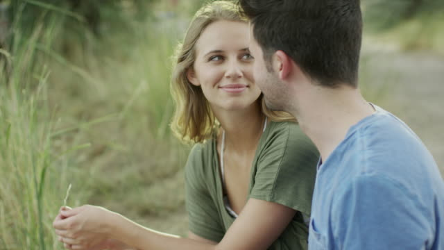 vidéos et rushes de medium slow motion shot of couple kissing / mona, utah, united states - embrasser sur la bouche