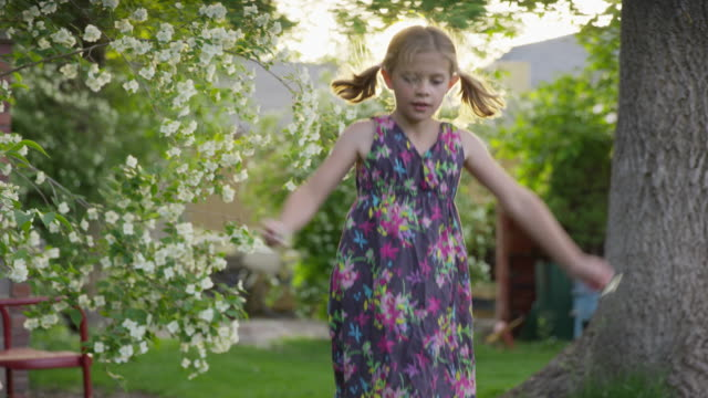 medium slow motion shot of girl dancing in yard / springville, utah, united states - springville utah stock videos & royalty-free footage