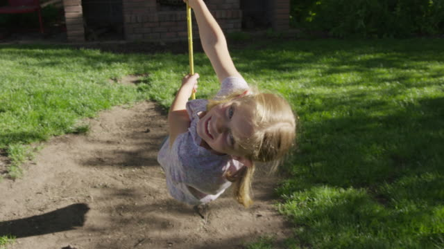 medium slow motion shot of girl looking at camera on rope swing / springville, utah, united states - springville utah stock videos & royalty-free footage