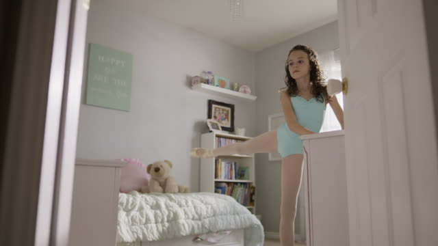 medium slow motion shot of girl practicing ballet in bedroom / provo, utah, united states - auf den zehenspitzen stock-videos und b-roll-filmmaterial