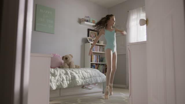 medium slow motion shot of girl practicing ballet in bedroom / provo, utah, united states - tiptoe stock videos & royalty-free footage