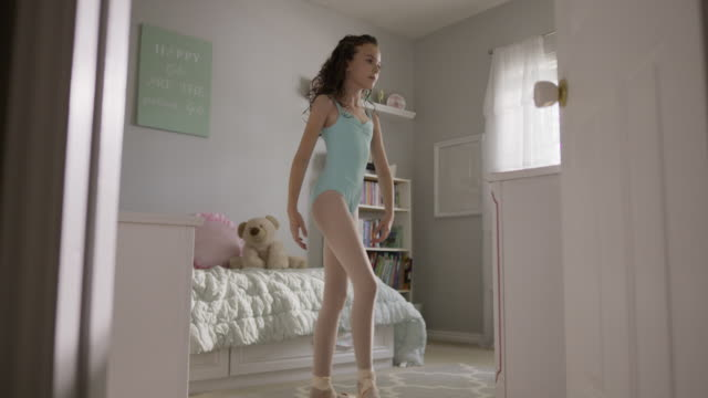 medium slow motion shot of girl practicing ballet in bedroom / provo, utah, united states - provo stock videos & royalty-free footage