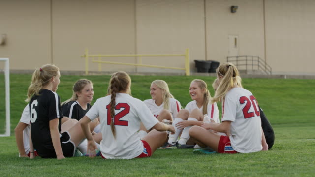 vidéos et rushes de medium slow motion shot of soccer opponents relaxing together / springville, utah, united states - springville utah