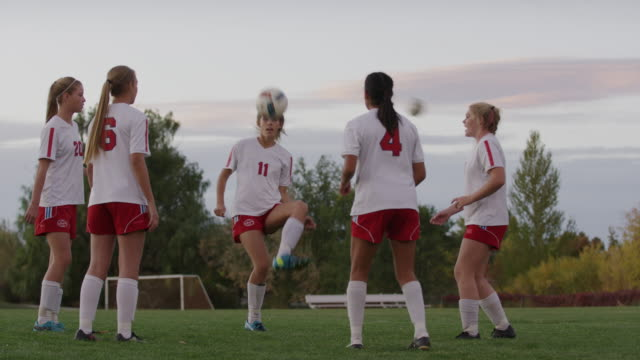 medium slow motion shot of soccer players practicing keepie uppie / springville, utah, united states - springville utah stock videos & royalty-free footage