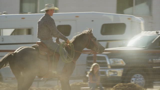 medium slow motion tracking short of man riding horse / lehi, utah, united states - lehi stock videos & royalty-free footage