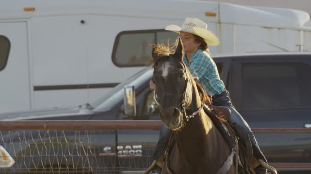 medium slow motion tracking shot of girl riding horse / lehi, utah, united states - lehi stock videos & royalty-free footage