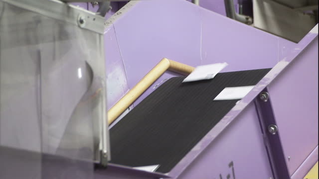 medium static - a conveyor belt moves mail / santa clarita, california - santa clarita stock videos & royalty-free footage