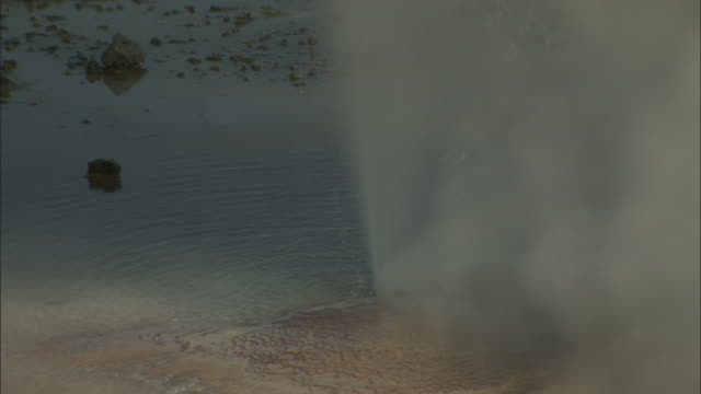 Medium static - A geyser erupts in Wyoming. / Wyoming, USA