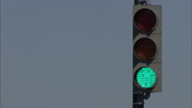 medium static - a traffic signal changes from green to red. / washington, d.c., usa - green light stoplight stock videos and b-roll footage