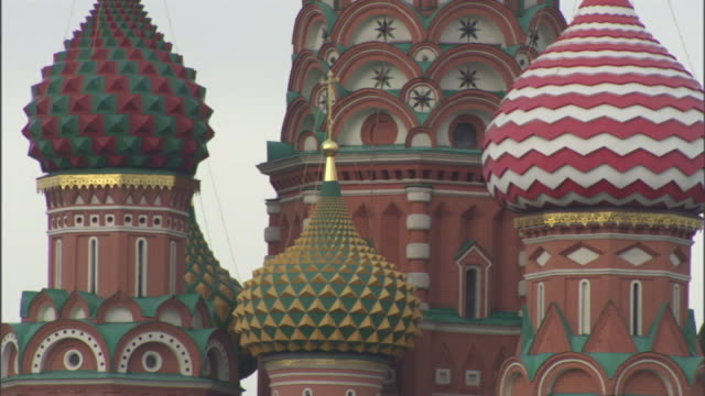 medium static - colorfully patterned onion domes top st. basil's cathedral in moscow. / moscow, russian federation - st. basil's cathedral stock videos and b-roll footage