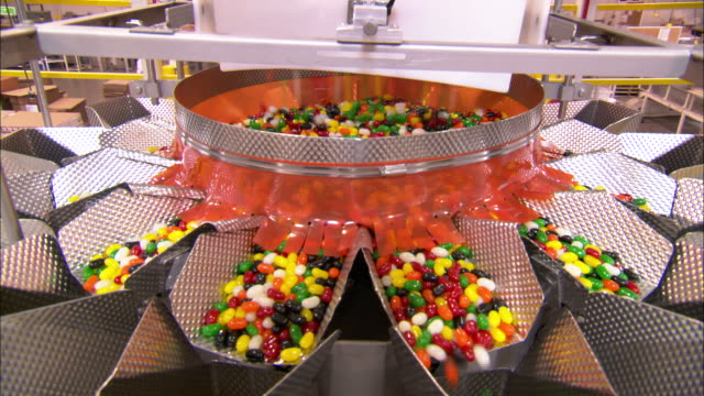 Medium static - Jellybeans pour into multiple chutes in a jelly bean factory /  Utah, United States